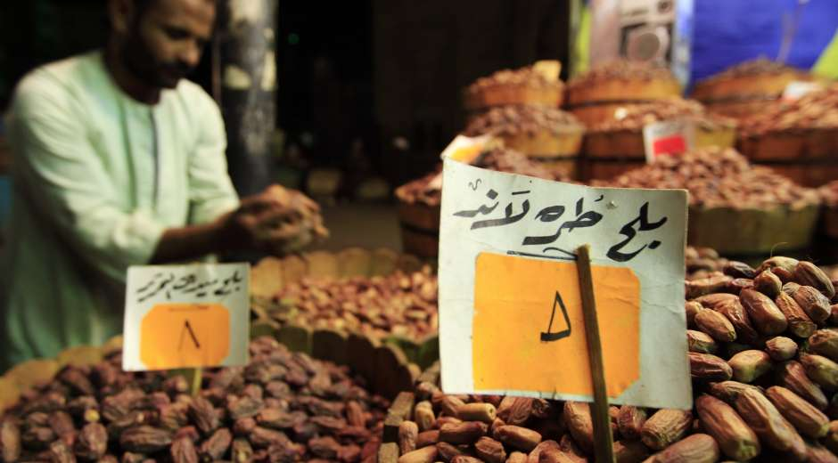 A shopkeeper checks his supplies of dates at a market ahead of the Islamic holy fasting month of Ramadan, in ...