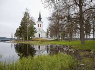 The beautiful Faagelvkg Church - Varmland, Sweden situated right down to a tranquil  lake.