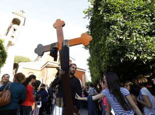 Assyrian Christians, who had fled the unrest in Syria, carry a wooden cross outside the Saint Georges ...