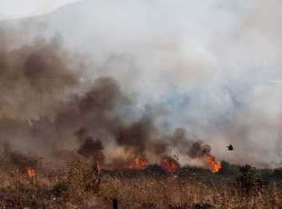 A fire near Kfar Sold, north of Israel, caused by four missiles fired from the Syrian side of the ...