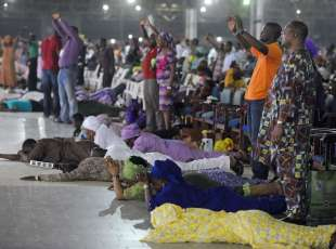 Worshippers pray into the New Year lying down during the crossover watch night church service at the ...