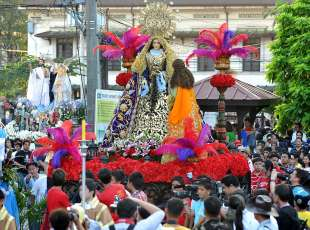 Believers display images of Virgin Mary during the Grand Marian Procession in Manila on December 5, 2010. The ...