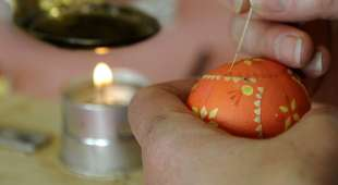 A woman decorates Easter eggs in a Sorbian wax technique on April 8, 2009 in Spremberg, eastern Germany. AFP ...