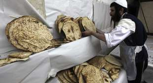 Ultra Orthodox Jewish men pack the baked Matzoth (unleavened bread) April 6, 2009 in Jerusalem. Religious ...