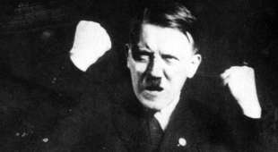 ADOLF HITLER (1889-1945). Chancellor of Germany, 1933-45. Photographed while practicing gestures to the ...