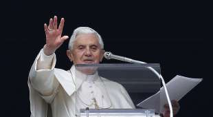Pope Benedict XVI waves to a crowd gathered in Saint Peter's square during his Sunday Angelus ...