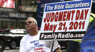 A man holds up a sign claiming that Judgement Day is coming in New York, May 13, 2011. Harold Camping, a ...