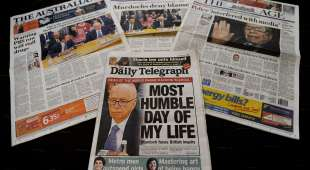 Australian newspaper front pages displayed in Sydney on July 20, 2011 detail the results of the appearance of ...