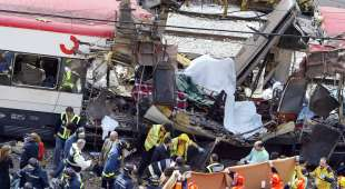 DECADE IN PICTURES Bodies of victims are evacuated after a train exploded near the Atocha train station in ...