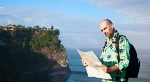 Man tourist with map at the