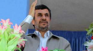 A handout picture released by Iranian President Mahmoud Ahmadinejad's official website shows Ahmadinejad ...