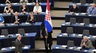 An usher holds a Croatian flag during a ceremony for Croatia''s accession to the European Union on ...