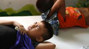 epa03182107 Filipino boys undergo circumcision conducted by military medical doctors in a slum area of ...