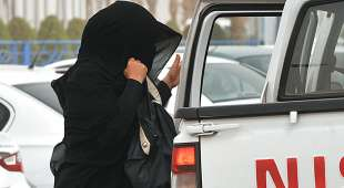 A Saudi woman gets out the backseat of a car on her way to a shopping mall in Riyadh on June 17, 2011 as a ...