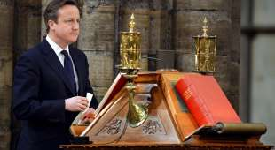 (FILES) In this file picture taken on March 3, 2014 Britain's Prime Minister David Cameron stands at a ...