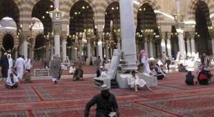 "Muslims pray and read the Koran at Al-Masjid al-Nabawi, or ""The Mosque of Prophet Mohammad"", after ..."