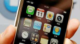 A model displays a new iPhone 3G with Chinese interface during its worldwide launch in Hong Kong July 11, ...