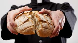 Symbol of Communion breaking loaf of
