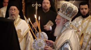 epa00696862 Ecumenical patriarch Bartholomew I, spiritual leader of the Greek Orthodox world, holds candles ...