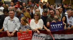LACONIA, NH - SEPTEMBER 15: Supporters watch as Republican Presidential nominee Donald Trump speaks at ...