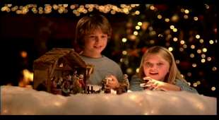 In this handout image from video provided by Wal-Mart, children are shown next to a nativity scene in a ...