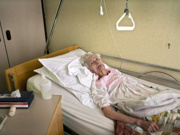Amelie Van Esbeen is pictured in her bed at the Saint-Bartholomeus elderly home in Merksem, on March 23, ...