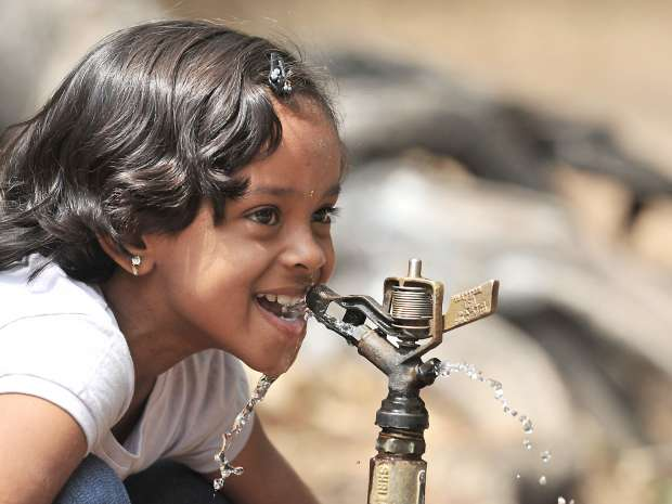 A young girl drinks water at the Nehru Zoological Park in Hyderabad on May 11, 2011. The only place in the ...