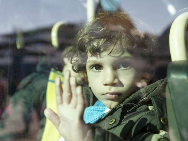 Refugee child at habour of Pireaus. Eventhough wintertime and difficult situation at borders, refugees ...