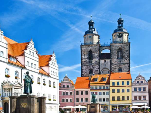 Market square in Wittenberg, main square of old german town. Monuments of Martin Luther and Philipp ...