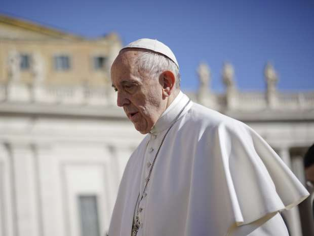 Pope Francis arrives for his weekly general audience in St.Peter's Square, at the Vatican, Wednesday, ...