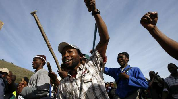 Striking workers demonstrate outside Cape Town's Green Point 2010 FIFA Soccer World Cup stadium, July 9, ...
