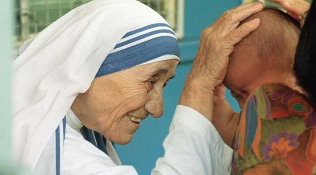 (FILES) Photo taken 20 October 1993 in Singapore of Mother Teresa blessing a child at the Gift of Love ...