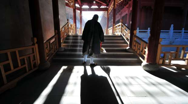 To go with AFP story by Robert J. Saijet: CHINA-RELIGION-BUDDHISM A buddhist nun performs her morning chore ...