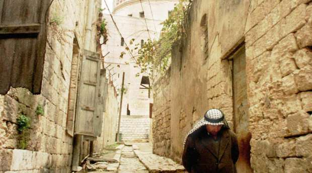 An Arab man walks along the narrow alley leading from the Church of the Annunciation .The alley has been ...