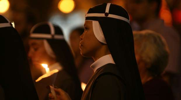 Christian pilgrims attend a candle-light vigil at the Church of the Nativity in the Palestinian biblical town ...