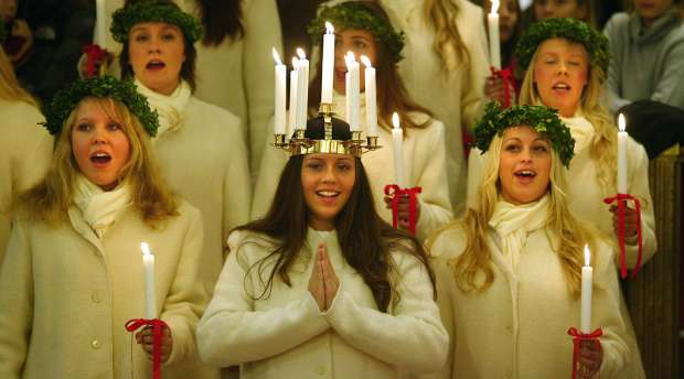Stockholm ´s Lucia 2003, Therese Andersson, 18, and her maids sing Santa Lucia and Christmas songs ...