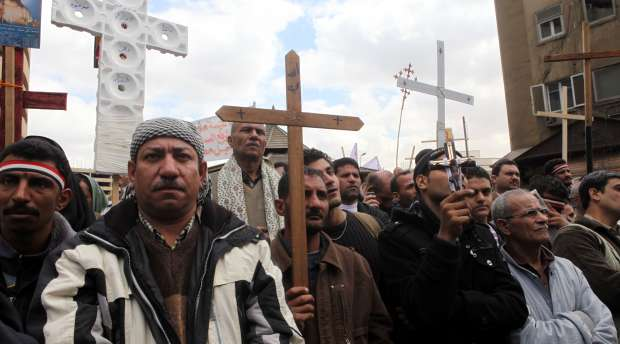 epa02625560 Egyptian Coptic Christians take part in a mass hounouring those killed in clashes two days ...