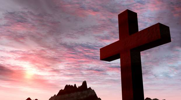 Red stone cross on a background of extremely storm sky and