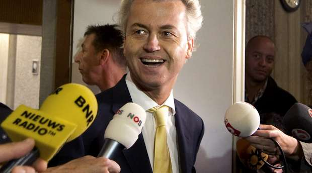 Dutch right-wing politician Geert Wilders of the Freedom Party leaves a courtroom in Amsterdam June 23, 2011. ...