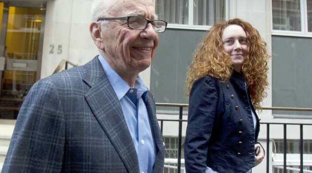 News Corporation CEO Rupert Murdoch is seen leaving his flat with Rebekah Brooks, chief executive of News ...