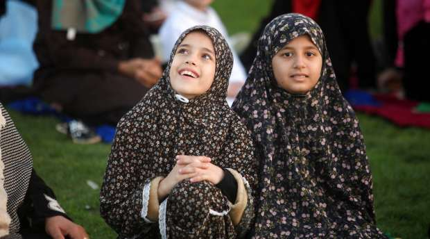 Palestinian girls attend Eid al-Adha prayers in Gaza City on Oct. 4, 2014. Muslims across the world are ...