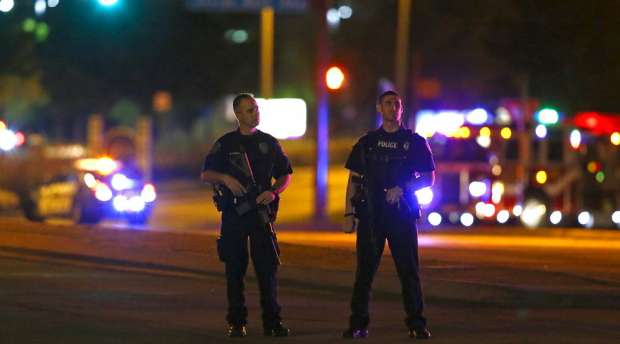 Police officers block an intersection near the Curtis Culwell Center after a shooting outside the Muhammad ...