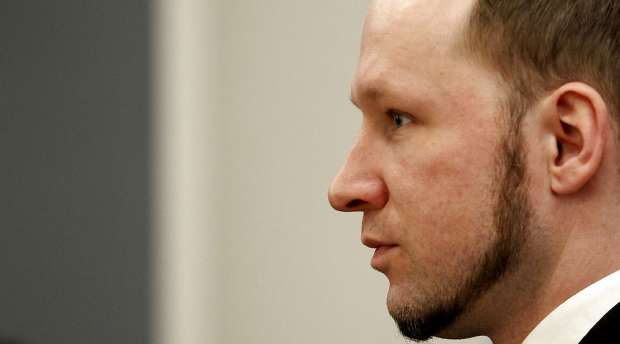 Norwegian mass killer Anders Behring Breivik reacts as he returns after a break to the court room, in Oslo ...