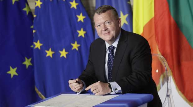 Danish Prime Minister Lars Lokke Rasmussen signs a declaration during an EU summit meeting at the Orazi and ...
